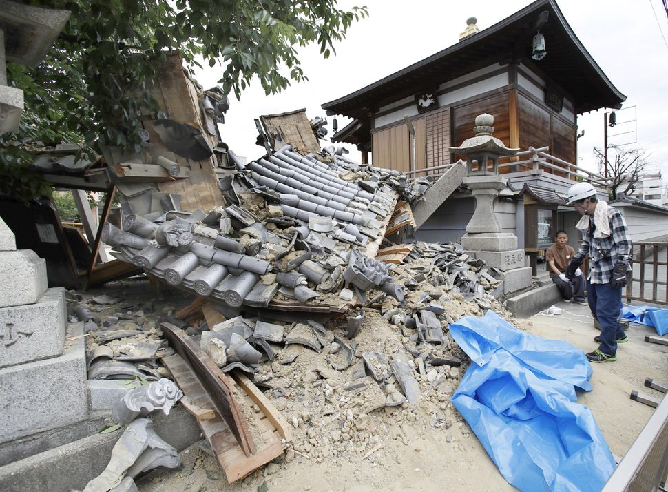 The Myotoku-ji temple was damaged by an earthquake on Monday in Ibaraki, Osaka prefecture.