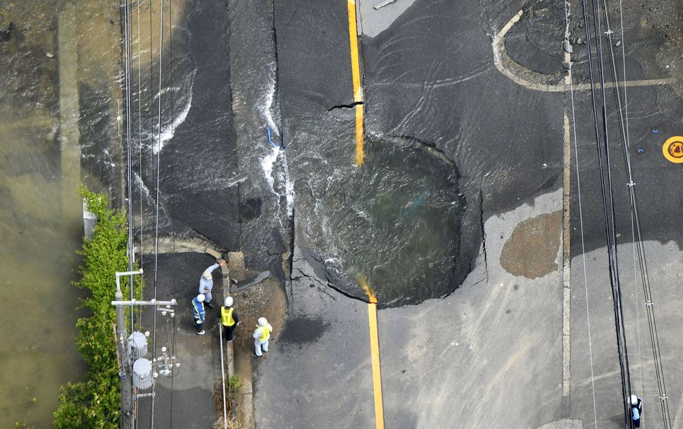 The quake damaged a road in Takatsuki, Osaka.