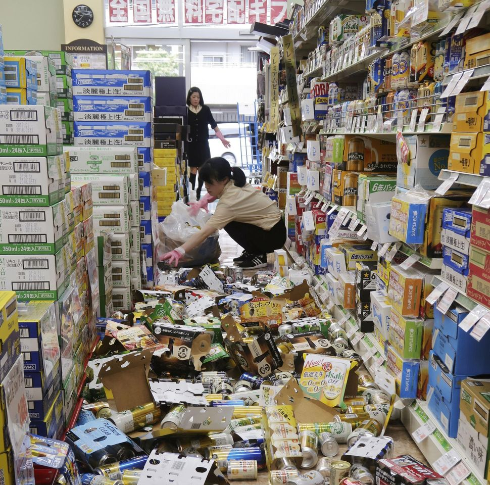 Bottles of alcohol went flying inside a liquor store in Hirakata during the temblor on Monday.