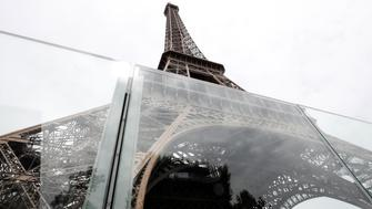 The new glass security fence, that is under construction, is seen around the Eiffel Tower in Paris, France, June 14, 2018. REUTERS/Benoit Tessier