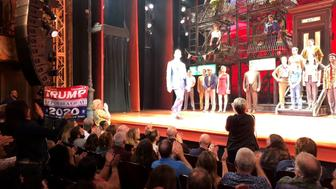 Handout photo taken with permission from the twitter feed of @joedelvicario_ as a Donald Trump supporter disrupted Robert De Niro's Broadway musical A Bronx Tale by standing at the front of the New York theatre and waving a ÒKeep America GreatÓ flag.