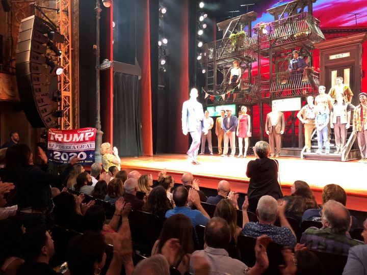 """As the cast from """"A Bronx Tale"""" took the curtain call, an audience member raised the banner."""
