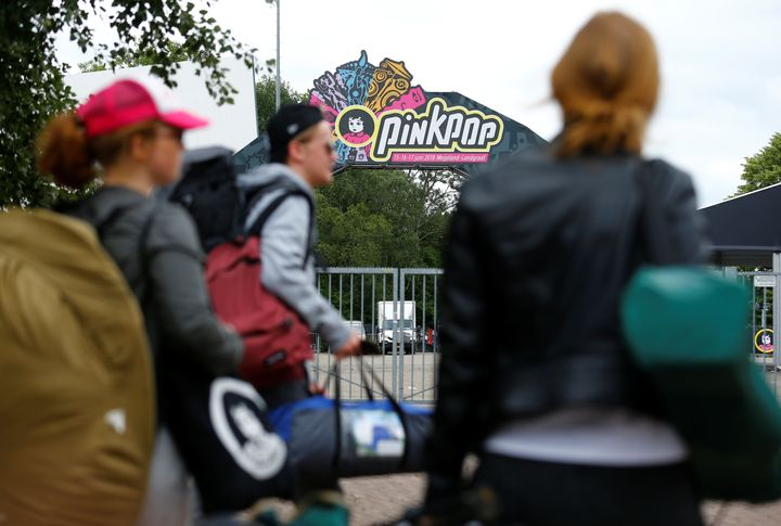 Visitors leave the grounds of the Pinkpop festival near where a van struck four people in Landgraaf, the Netherlands, on June