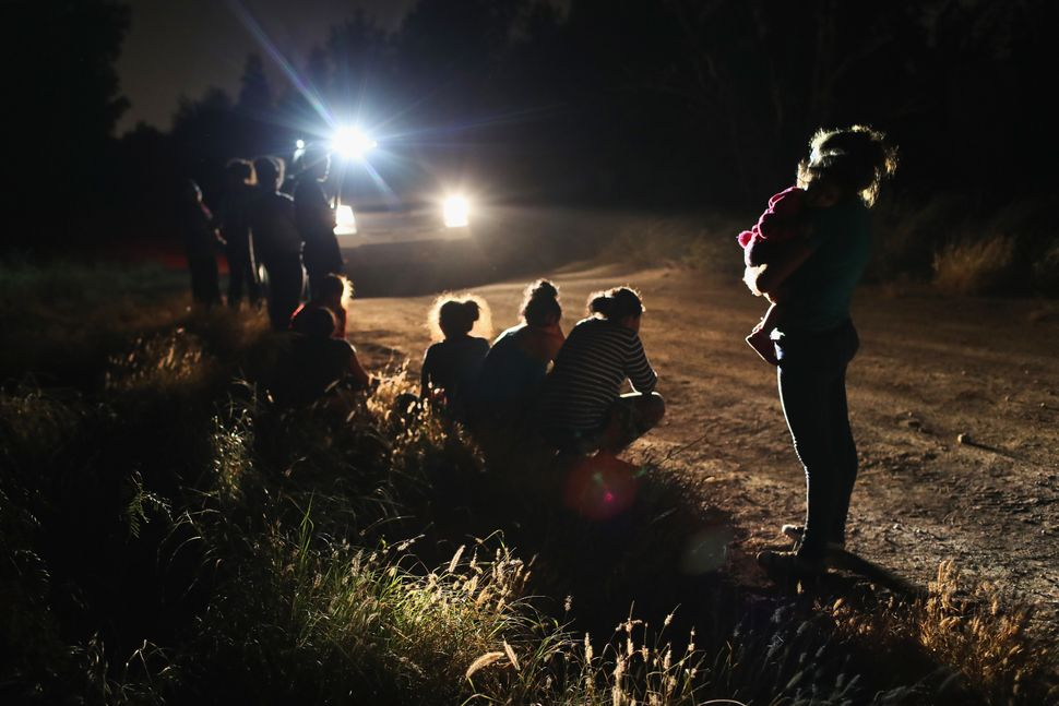 U.S. Border Patrol agents arrive to detain a group of Central American asylum seekers near the U.S.-Mexico border on June 12,