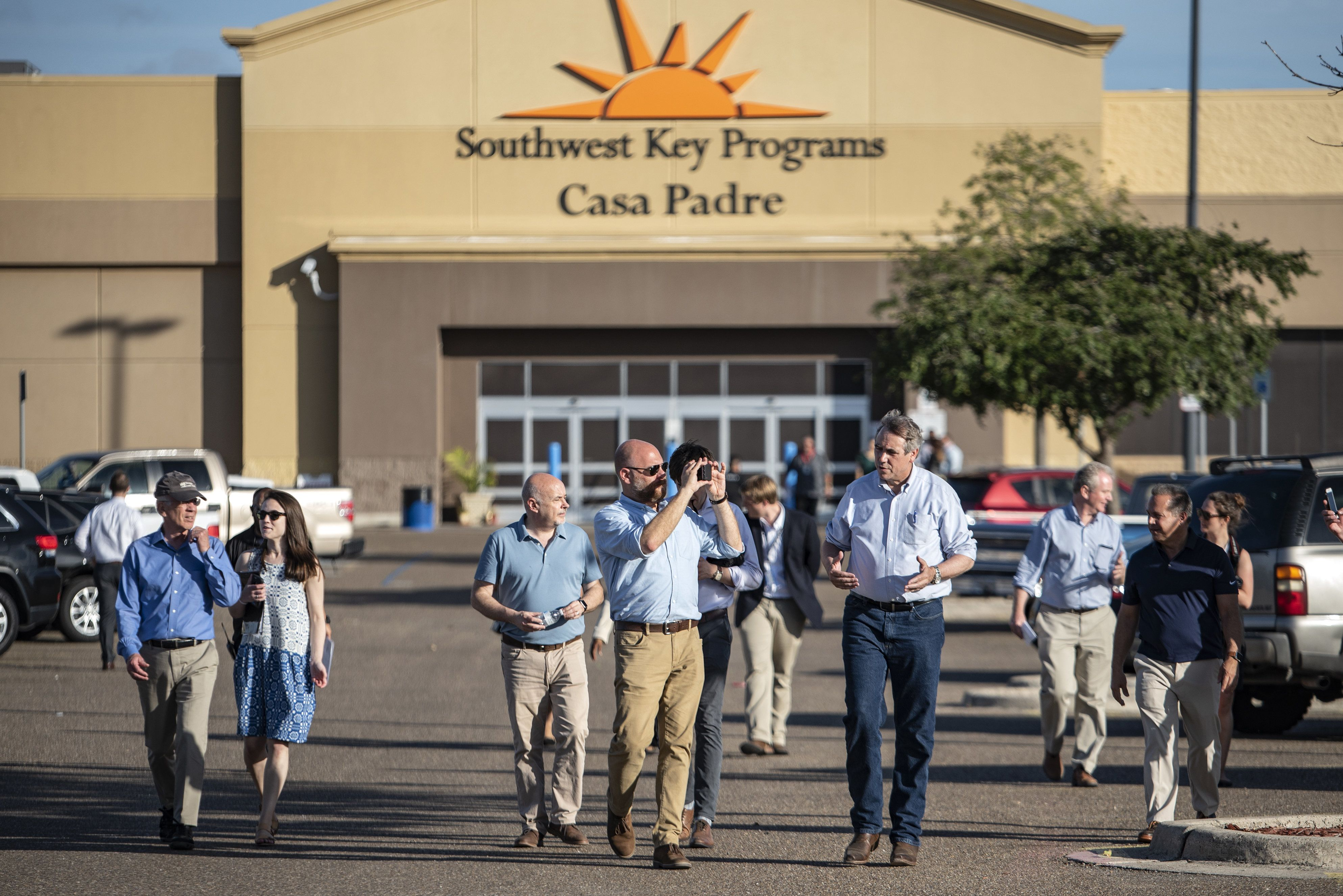 Senator Jeff Merkley, a democrat from Oregon, fourth from right, leaves the Southwest Key-Casa Padre Facility, formerly a Walmart Inc. store, stands in Brownsville, Texas, U.S., on Sunday, June 17, 2018. Democrats escalated their attacks on President Donald Trump's policy of separating immigrant children from parents who illegally cross the Mexican border, as public outrage over the practice balloons into an election-year headache for Republicans. Photographer: Sergio Flores/Bloomberg via Getty Images