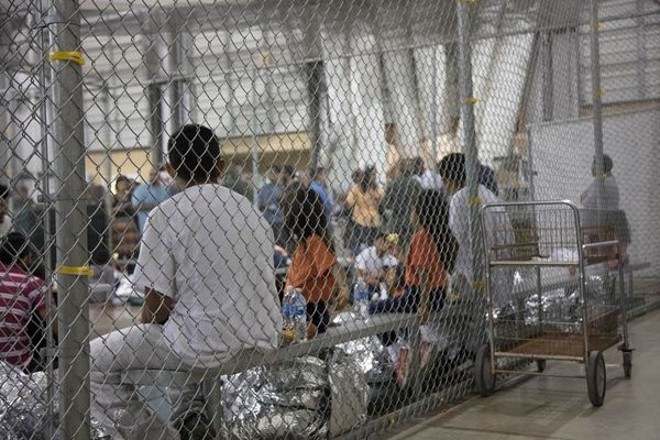 Families are pictured here together, although the Trump administration has separated almost 2,000 children from their parents