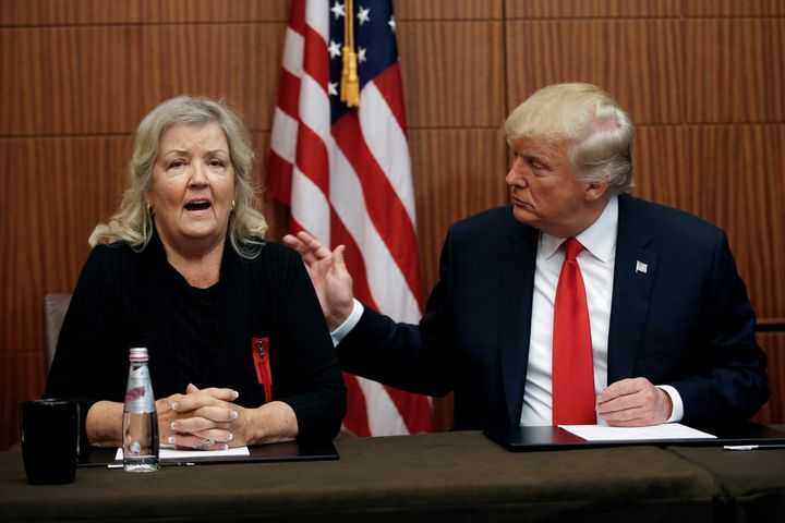 Juanita Broaddrick, who says that Bill Clinton raped her in 1975, sits with then-presidential candidate Donald&nbsp