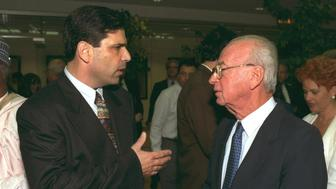 Former Israeli Prime Minister Yitzhak Rabin speaks with former energy minister Gonen Segev during a conference in Jerusalem, in this file photo released by the Israeli Government Press Office (GPO), obtained by Reuters on June 18, 2018. REUTERS/GPO/Handout ATTENTION EDITORS - THIS IMAGE HAS BEEN SUPPLIED BY A THIRD PARTY. ISRAEL OUT.