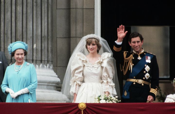Newlyweds Prince Charles and Lady Diana with Queen Elizabeth at Buckingham Palace after the ceremony.