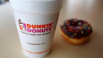 "A drink and a doughnut are seen at a Dunkin' Donuts location in the Chicago suburb of Niles, Illinois, February 4, 2015.  REUTERS/Jim Young/File Photo   GLOBAL BUSINESS WEEK AHEAD PACKAGE - SEARCH ""BUSINESS WEEK AHEAD JULY 18"" FOR ALL IMAGES"