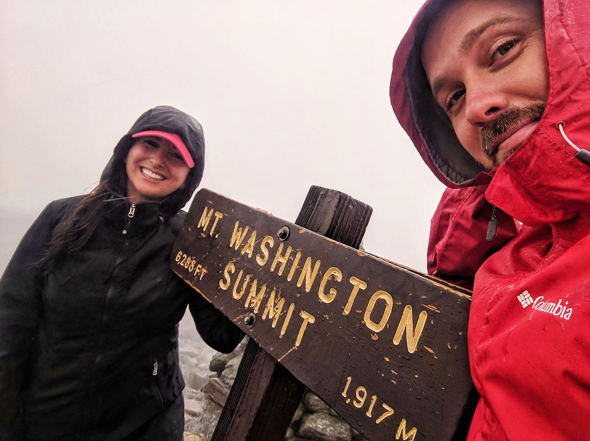 Hailey and Mitch on the summit of Mount Washington in the White Mountains of New Hampshire.