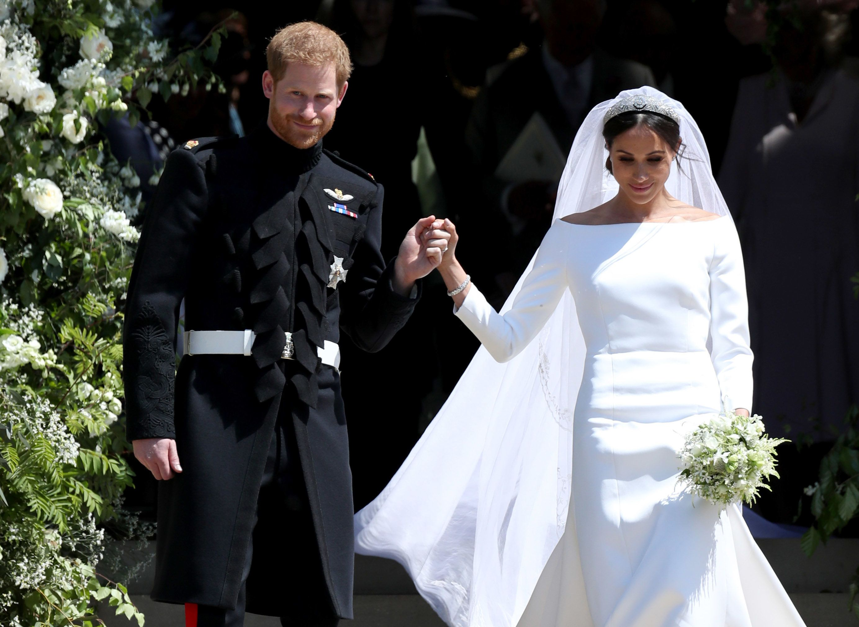 Prince Harry Duke of Sussex and Meghan Duchess of Sussex depart after their wedding ceremony at St. George's Chapel at Wi