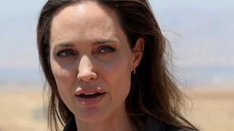U.N. Refugee Agency's special envoy Angelina Jolie speaks during a news conference during her visits to a camp for Syrian refugees in Dohuk, Iraq June 17, 2018.  REUTERS/Ari Jalal