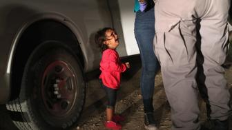 MCALLEN, TX - JUNE 12:  A two-year-old Honduran asylum seeker cries as her mother is searched and detained near the U.S.-Mexico border on June 12, 2018 in McAllen, Texas. The asylum seekers had rafted across the Rio Grande from Mexico and were detained by U.S. Border Patrol agents before being sent to a processing center for possible separation. Customs and Border Protection (CBP) is executing the Trump administration's 'zero tolerance' policy towards undocumented immigrants. U.S. Attorney General Jeff Sessions also said that domestic and gang violence in immigrants' country of origin would no longer qualify them for political asylum status.  (Photo by John Moore/Getty Images)