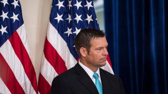 WASHINGTON, DC - JULY 19: Kansas Secretary of State Kris Kobach listens as Vice President Mike Pence speaks at the first meeting of the Presidential Advisory Commission on Election Integrity at the Eisenhower Executive Office Building on the White House complex in Washington, DC on Wednesday, July 19, 2017. (Photo by Jabin Botsford/The Washington Post via Getty Images)