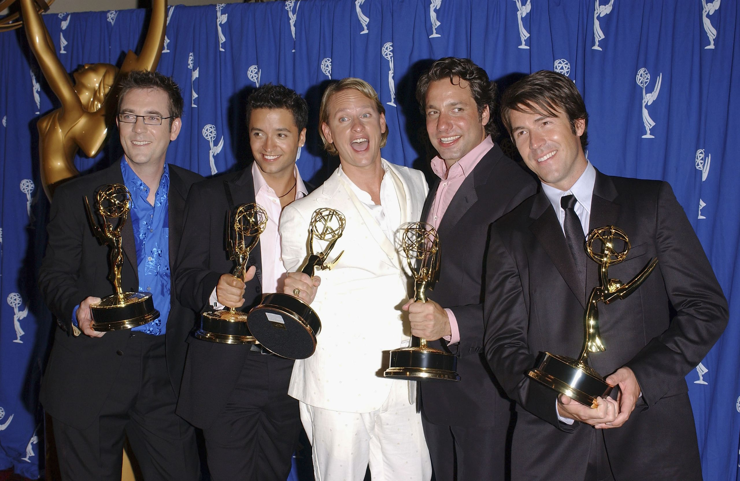 The OG Fab Five in 2004, with their Emmys for Outstanding Structured Reality Program.