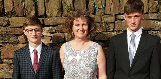 Tracey-Jane Hughes with her two sons Ben, 16, and Jack,