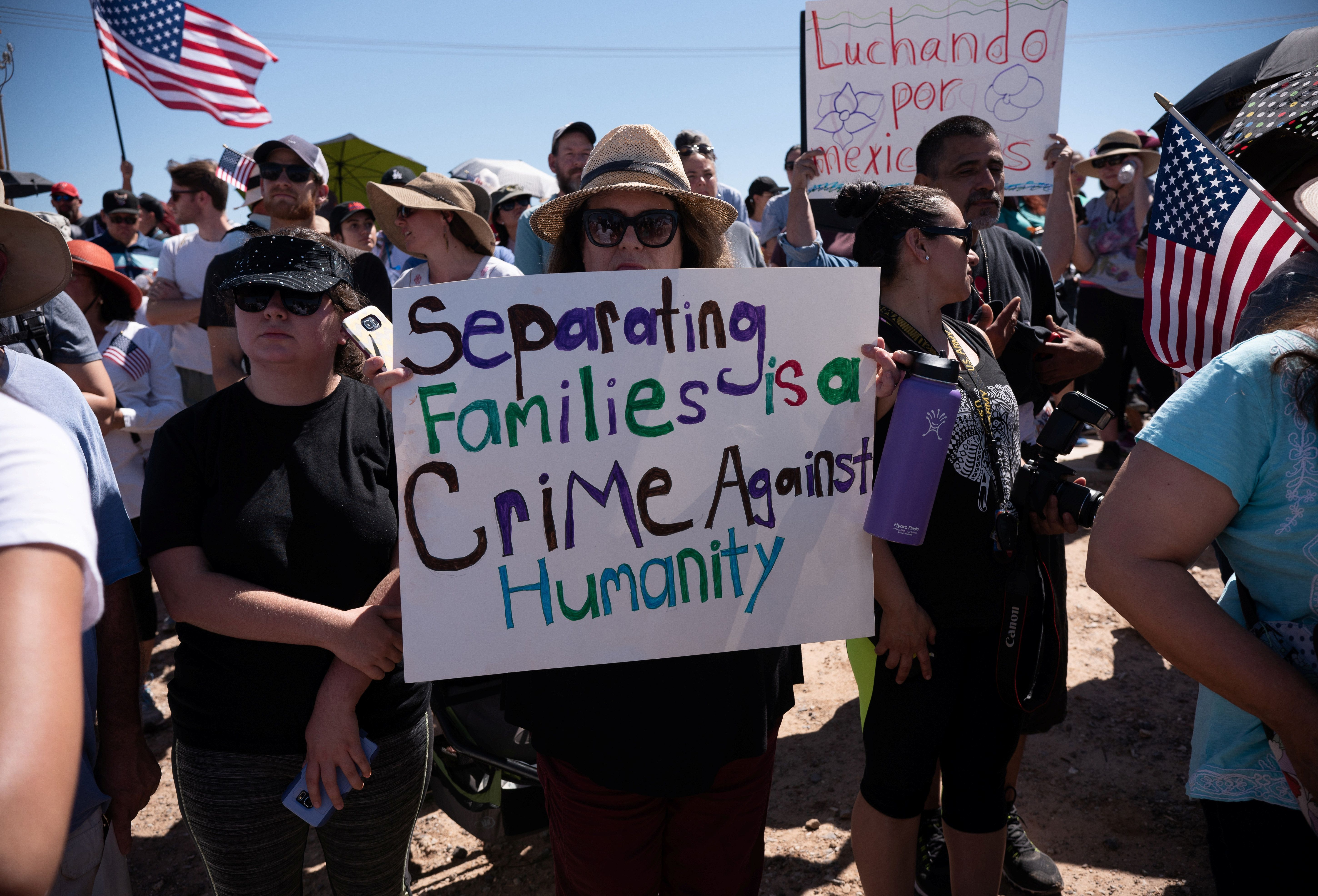 People participate in a protest against a recent U.S. immigration policy of separating children from their families when they enter the United States as undocumented immigrants, outside the Tornillo Tranit Centre, in Tornillo, Texas, U.S. June 17, 2018. REUTERS/Monica Lozano
