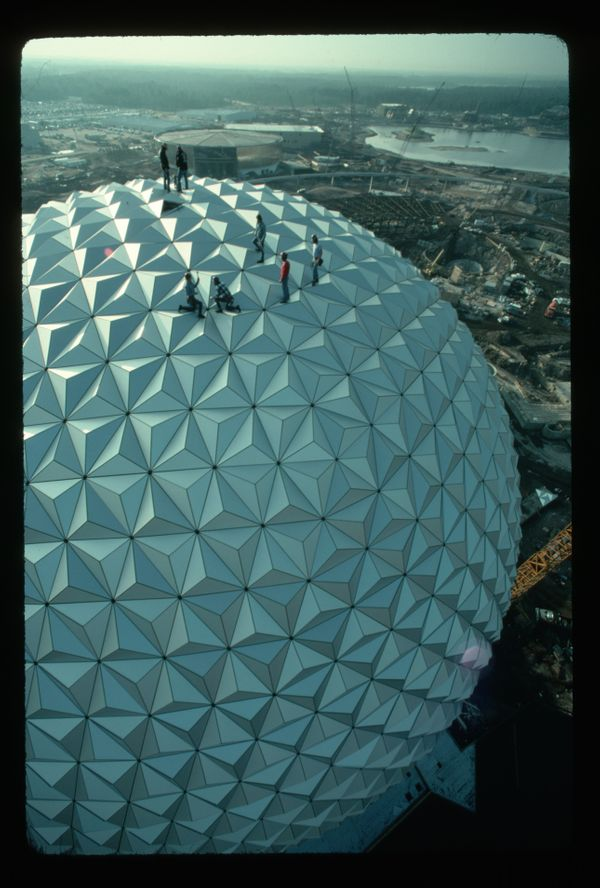 Workers complete the final stages of construction for Epcot's Spaceship Earth at Disney World. Epcot opened in 1982.