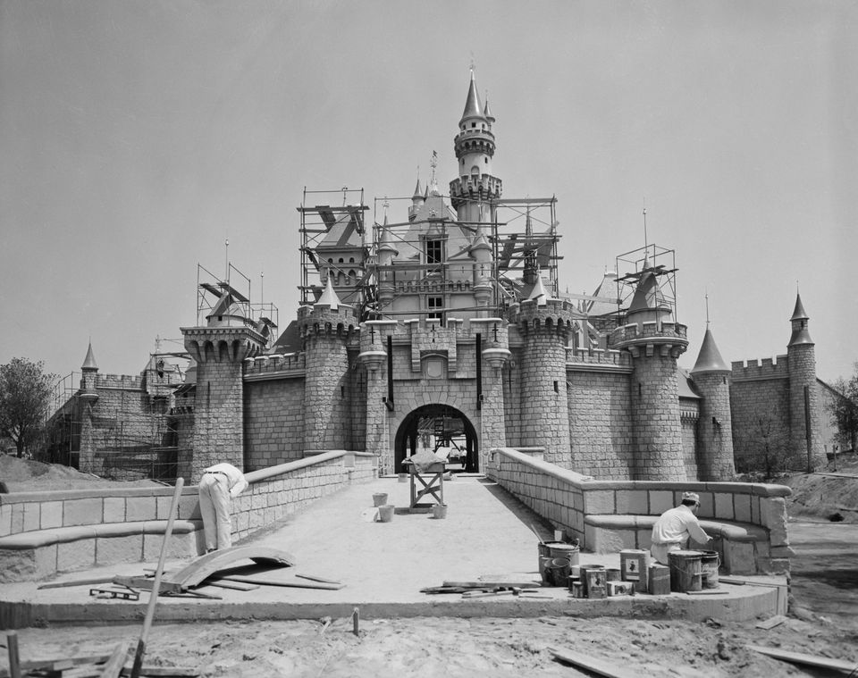 Workmen (in the foreground) help ready Sleeping Beauty Castle for Disneyland's opening in July 1955.