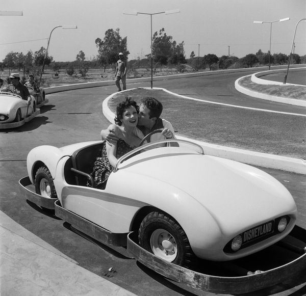 Actors Steve Rowland and Kathleen Case on a ride during Disneyland's opening day.