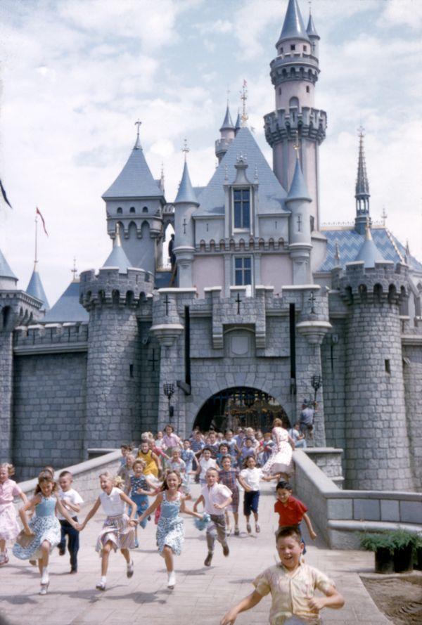 Kids cavort outside Sleeping Beauty Castle in 1955.