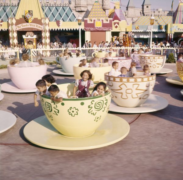 Kids ride the teacups at Disneyland's Mad Tea Party ride in 1955.