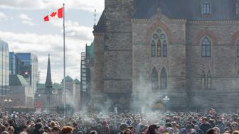 Smoke lingers over Parliament Hill as people smoke marijuana during the annual 4/20 rally on Parliament Hill in Ottawa, Ontario on April 20, 2018. (Photo by Lars Hagberg / AFP)        (Photo credit should read LARS HAGBERG/AFP/Getty Images)