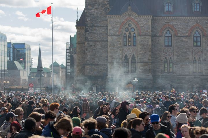 Smoke lingers over Parliament Hill in Ottawa, Ontario, as people smoke marijuana during the annual 4/20 rally on April 20, 20