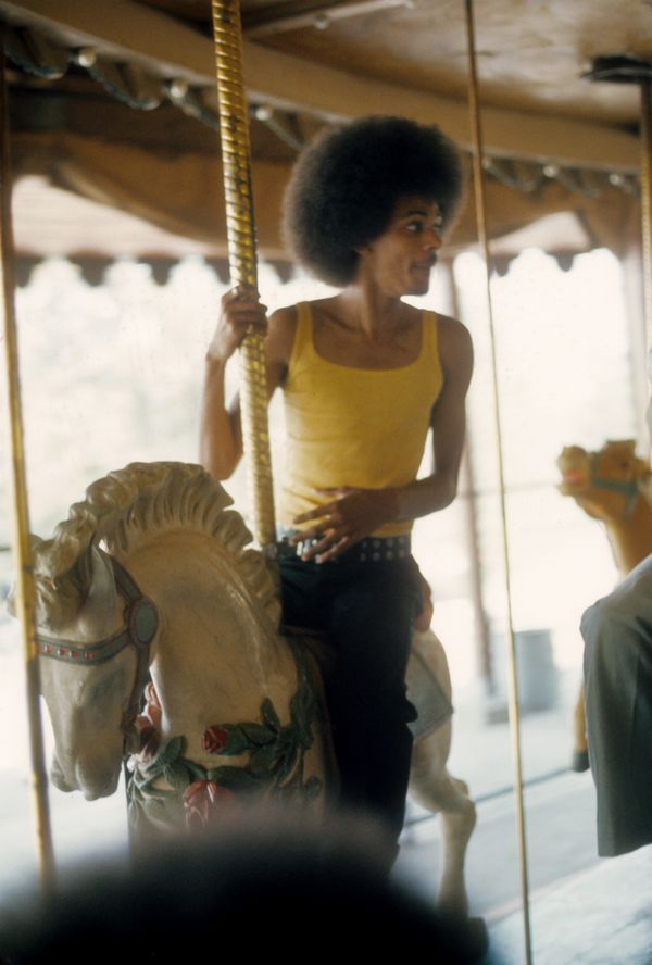 James Sylvers of R&B group The Sylvers rides the carousel at Disneyland in 1973.