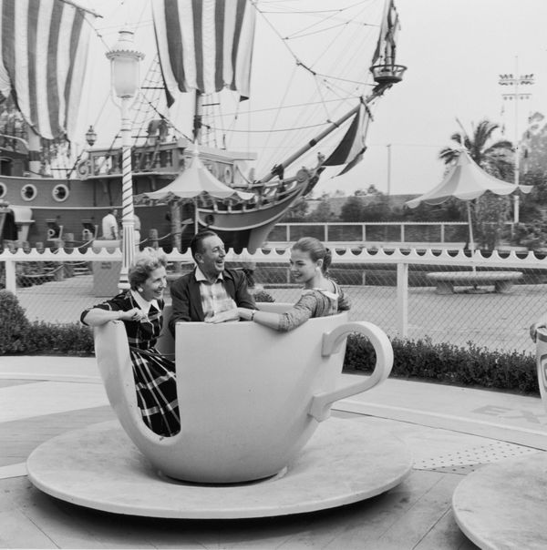 Disney rides a spinning teacup with his wife, Lillian, and their daughter, Diane, shortly after Disneyland's opening.