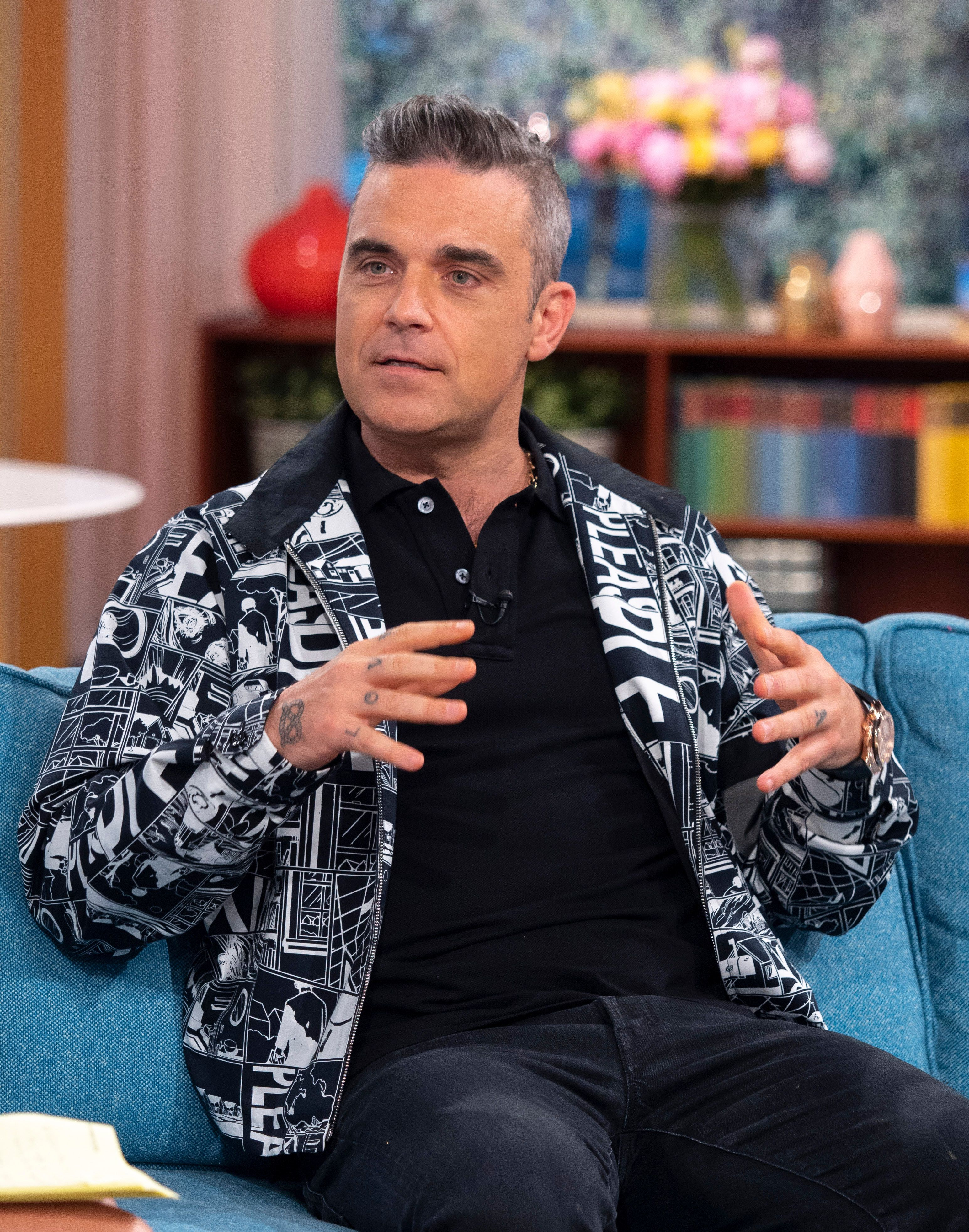 Robbie Williams Explains Why He Flipped The Bird During World Cup Opening Ceremony