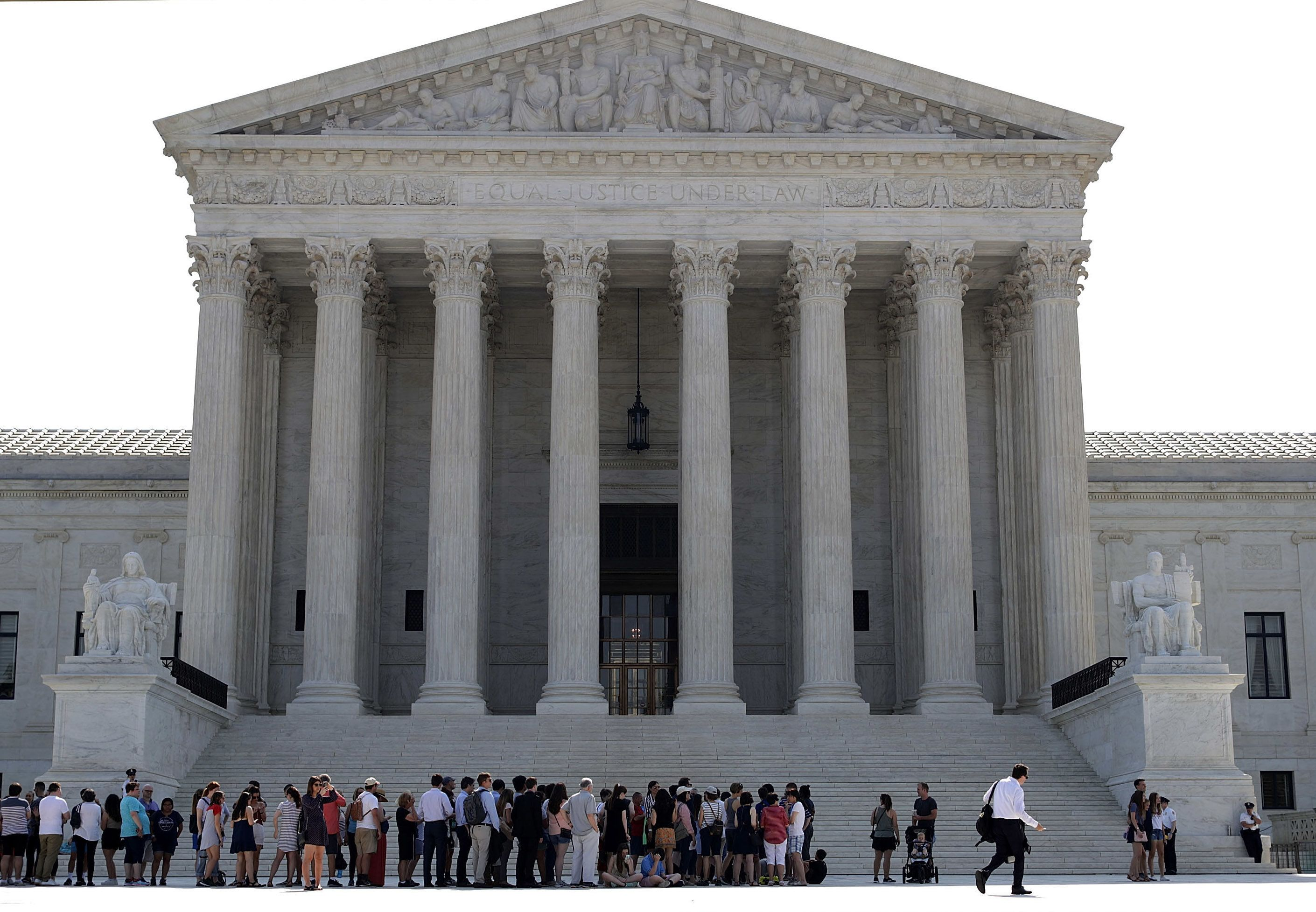 WASHINGTON, DC - JUNE 18:  Visitors line up outside the U.S. Supreme Court plaza before the court handed down decisions June 18, 2018 in Washington, DC. The court handed down opinions in five cases, including decisions about sentencing guidelines, gerrymandering and other topics.  (Photo by Chip Somodevilla/Getty Images)