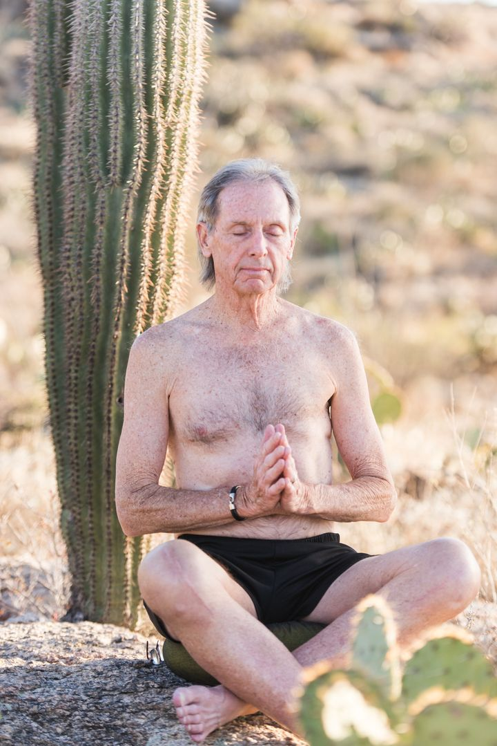 Khevin sits in meditation at Saguaro National Park in Arizona.
