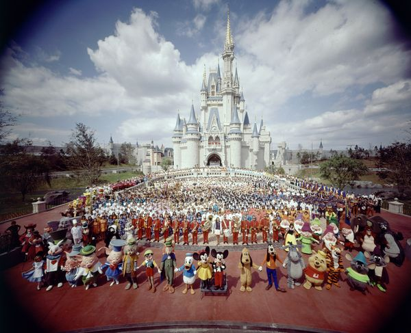 The Disney World staff poses for a photo to celebrate the park's opening.