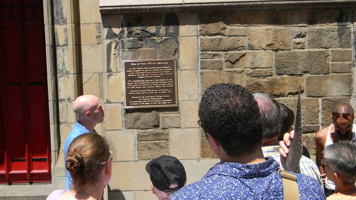 A plaque memorializes the site of the first PFLAG meeting at the Church of the Village on March 11, 1973.