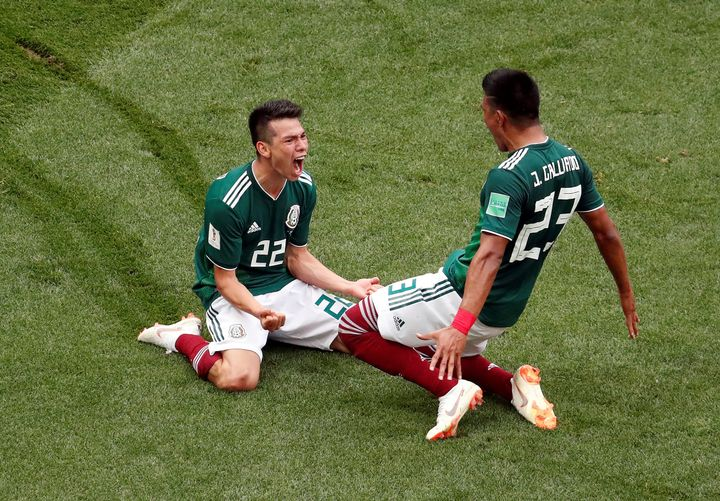 Hirving Lozano (left) celebrates scoring Mexico's first goal with Jesús Gallardo in Moscow on June 17.