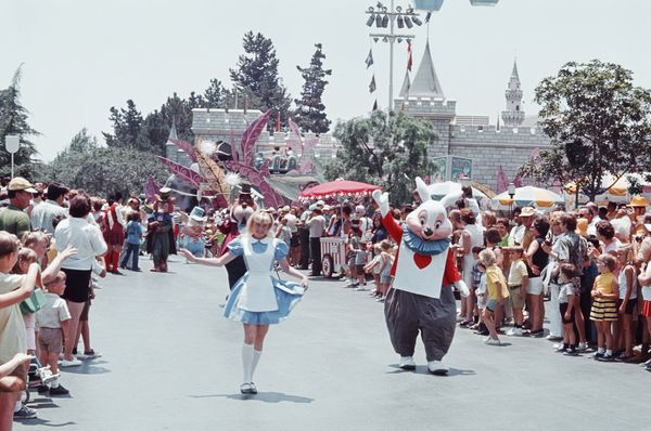 Characters greet guests during a parade at Disneyland in 1970.