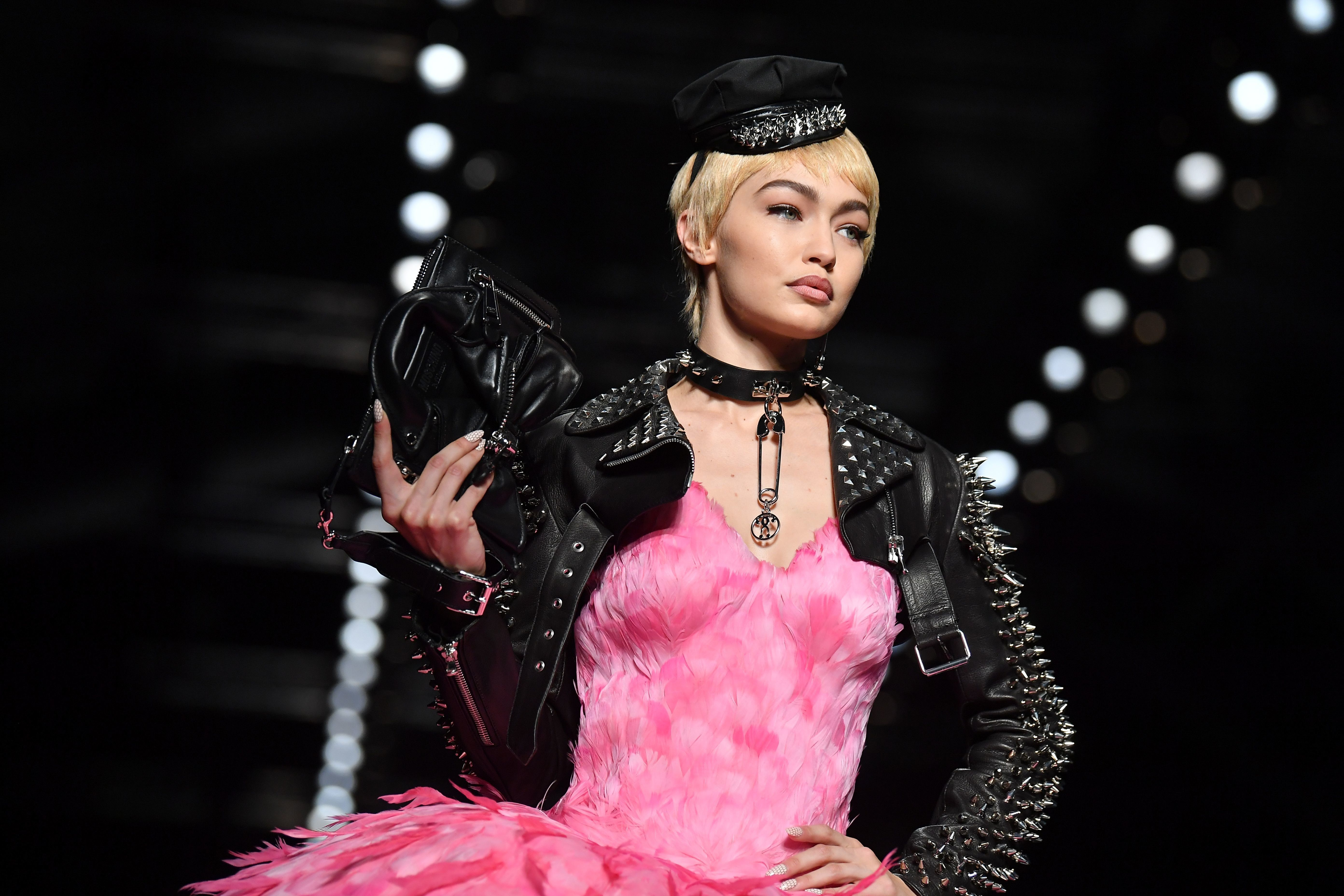 Model Gigi Hadid presents a creation for fashion house Moschino during the Women's Spring/Summer 2018 fashion shows in Milan, on September 21, 2017.  / AFP PHOTO / Marco BERTORELLO        (Photo credit should read MARCO BERTORELLO/AFP/Getty Images)