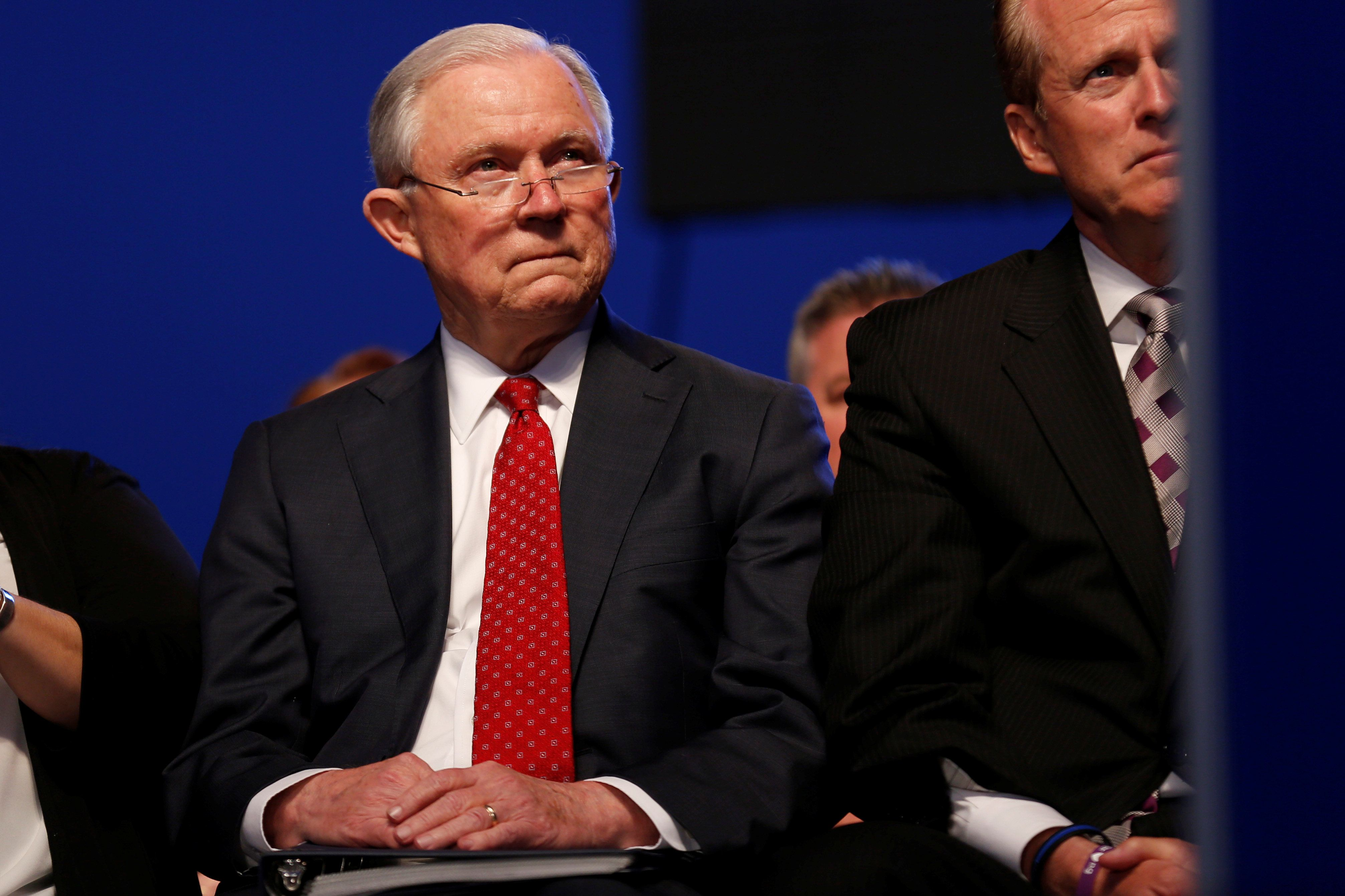 U.S. Attorney General Jeff Sessions waits to deliver remarks at the National Law Enforcement Officers Memorial Fund's 30th annual candlelight vigil in Washington, U.S., May 13, 2018.      REUTERS/Joshua Roberts