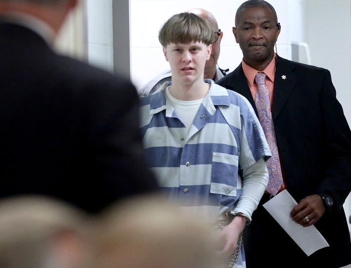 """U.S. District Judge Richard Gergel criticized what he called """"abysmally poor"""" FBI policies for the system that allowed Dylann Roof, center, to buy the gun he used to kill nine people, all African-Americans, at a historic black church in Charleston."""