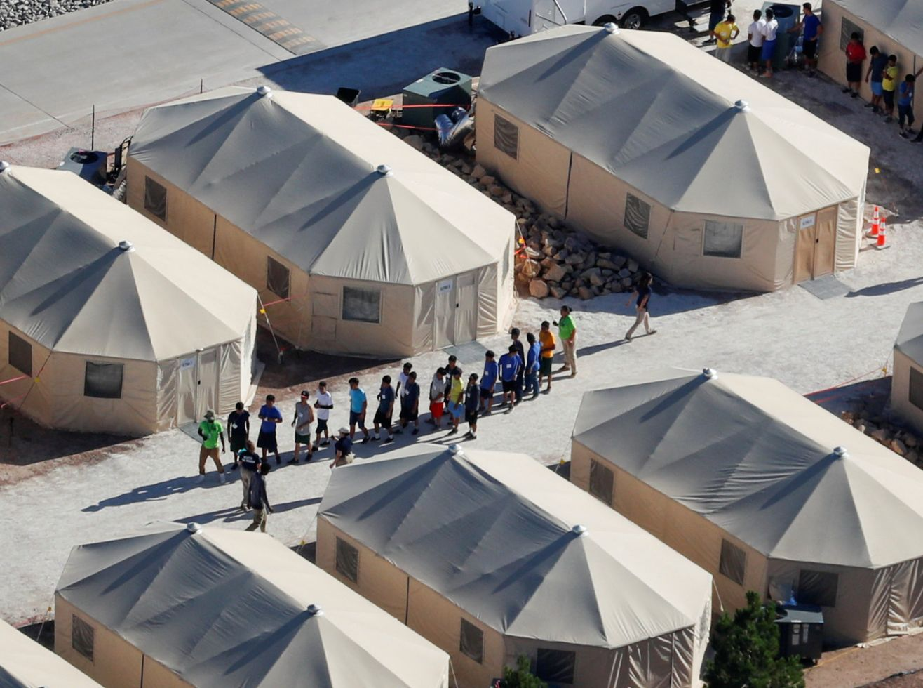 Immigrant children now housed in a tent encampment under the new 'zero tolerance' policy by the Trump...