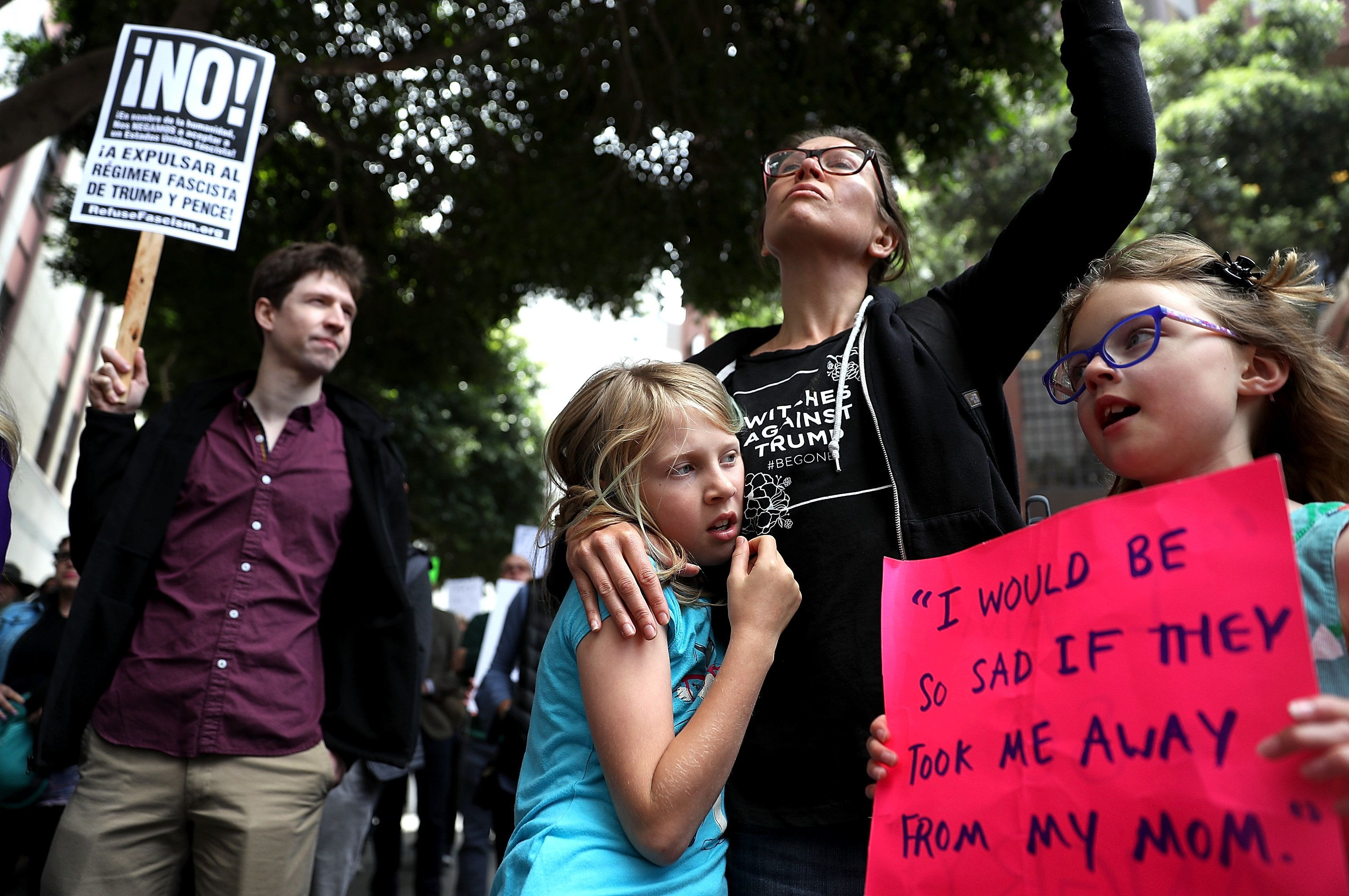 SAN FRANCISCO, CA - JUNE 19:  Kate Schatz (C) stands with her daughter Ivy Pontius (L) and Annea Berggren-Briggs (R) during a demonstration outside of the San Francisco office of the Immigration and Customs Enforcement (ICE) on June 19, 2018 in San Francisco, California. Hundreds of protesters staged a demonstration outside of the ICE offices in San Francisco against the Trump administration's zero tolerance policy to separate immigrant families at the border.  (Photo by Justin Sullivan/Getty Images)