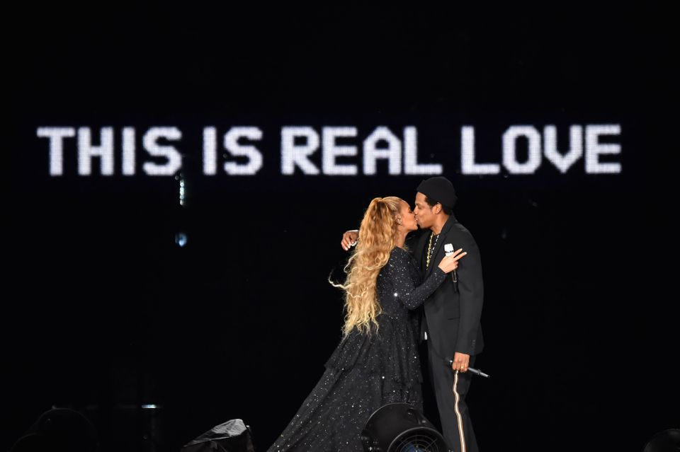 Beyoncé and Jay-Z kiss ending their performance onstage during the On the Run II Tour on June