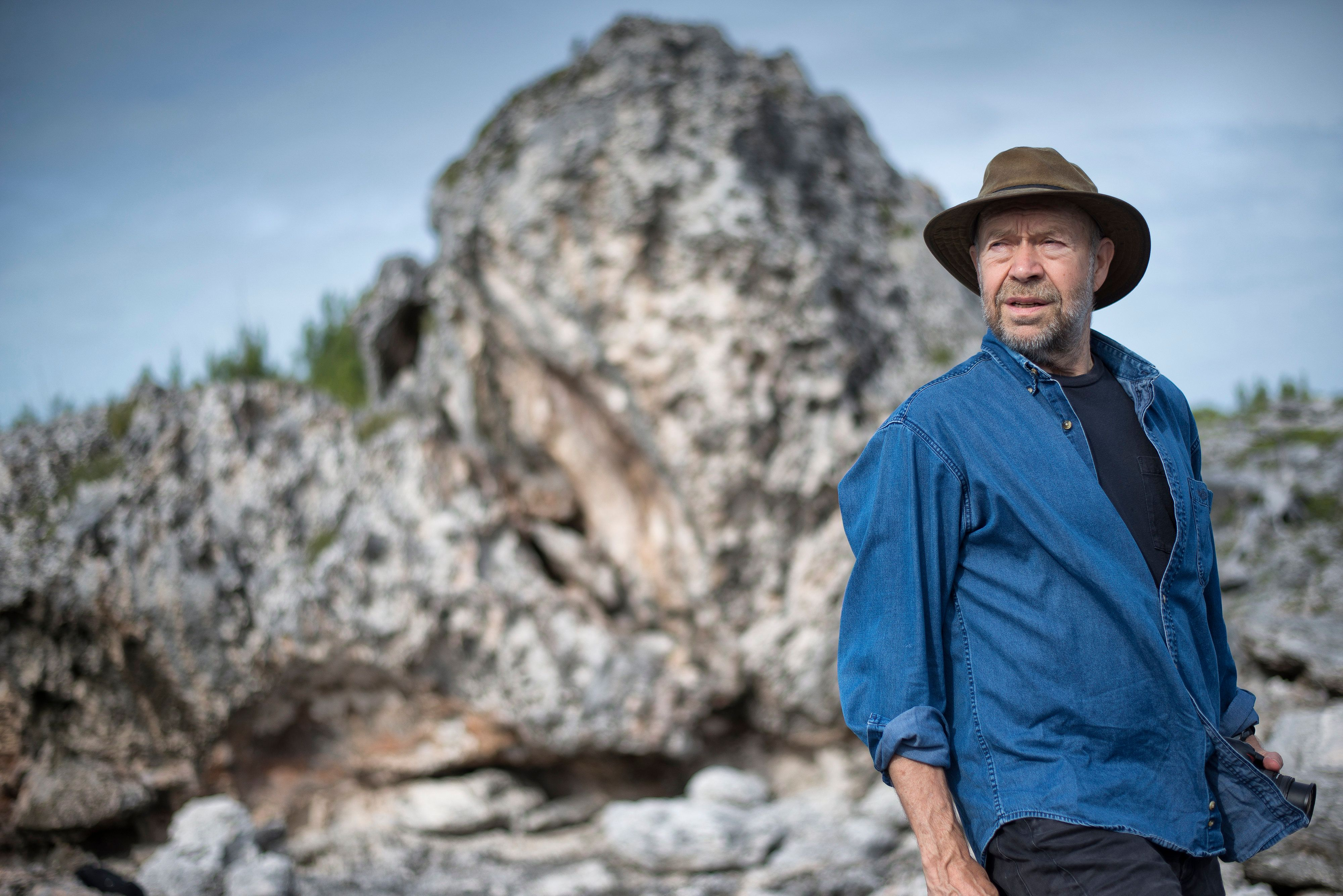 GREGORY TOWN, BAHAMAS - NOVEMBER 22: World renowned climatologist James Hansen on the Eleuthera coastal ridge on November 22, 2015 in Eleuthera, Bahamas. The theory put out by Paul Hearty, a coastal geologist at the University of North Carolina at Wilmington is that the massive boulders was catapulted onto land by a series of intense storms. The boulders now sit delicately perched on the coastal ridge in North Eleuthera. (Photos by Charles Ommanney/The Washington Post via Getty Images)