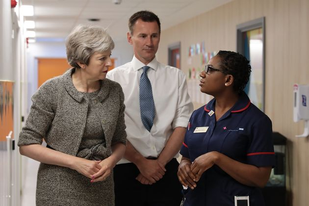 Theresa May with health secretary Jeremy Hunt meet a nurse at the Royal Free