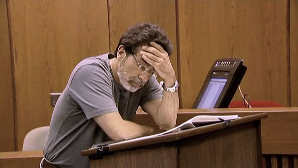 David Rudolf practicing his opening statement in a scene from