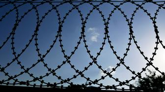 A barbed wire fence with razor sharp wires.