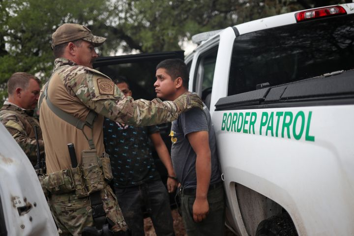 Members of the Border Patrol Search, Trauma, and Rescue (BORSTAR) unit apprehend migrants from Guatemala near Falfurrias, Tex