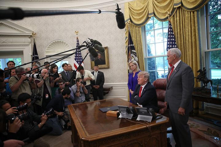 President Donald Trump, accompanied by Department of Homeland Security Secretary Kirstjen Nielsen and Vice President Mike Pen